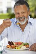 Middle Aged Man Dining Al Fresco - stock photo