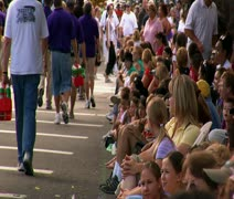 Spectators watch parade Stock Footage
