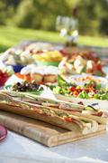 Al Fresco Dining, With Food Laid Out On Table Stock Photos