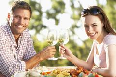 Couple Eating An Al Fresco Meal - stock photo