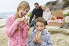 Family Dining Al Fresco At The Beach Stock Photos
