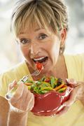 Senior Woman Eating Fresh Salad Stock Photos