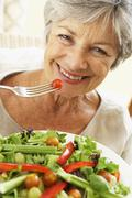 Senior Woman Eating Healthy Salad - stock photo