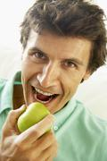 Mid Adult Man Eating A Healthy Apple - stock photo