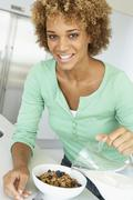 Mid Adult Woman Eating Healthy Breakfast - stock photo