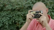 Man with an old camera Stock Footage