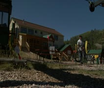 Mountain bikers settle on Summer chairlift Stock Footage