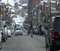 Traffic and snow falling On Main St., Park city Utah Stock Footage