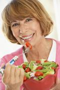 Middle Aged Woman Eating A Fresh Green Salad Stock Photos