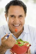 Senior Man Eating A Fresh Green Salad - stock photo