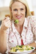 Mid Adult Woman Eating A Healthy Meal - stock photo