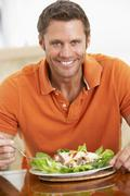 Middle Aged Man Eating A Healthy Meal - stock photo