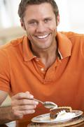Middle Aged Man Eating Chocolate Cake Stock Photos