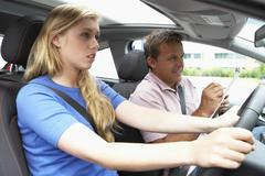 Teenage Girl Taking A Driving Lesson - stock photo