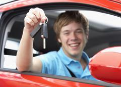 Teenage Boy Sitting In Car Holding Car Keys - stock photo