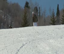 Mother and kid-son skiiers enjoy the slopes Stock Footage