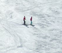 Skiiers wait on hill while other pass by Stock Footage