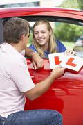 Teenage Girl Receiving Her Learner Plates Stock Photos