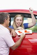 Teenage Girl Receiving Her Learner Plates - stock photo
