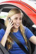 Teenage Girl Sitting In Car Talking On Cellphone Stock Photos