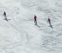Stock Video Footage of A group of three skiiers turn in formation