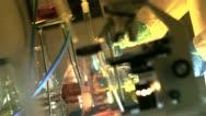 Laboratory tech stirring a liquid Stock Footage