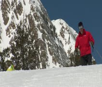Ski-dad and snowboard-mom with kid on skiis Stock Footage