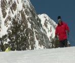Ski-dad and snowboard-mom with kid on skiis Stock Footage