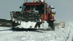 Snowcat moving in the snowfield - stock footage