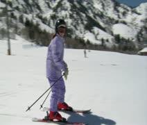Little skier dressed in pale purple snowsuit Stock Footage