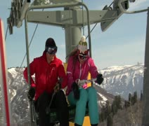 Teen skiers get off chairlift Stock Footage