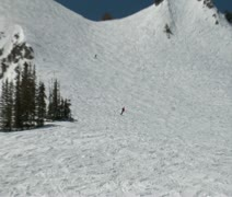 Zoom in on telemark skier on hilly slope Stock Footage