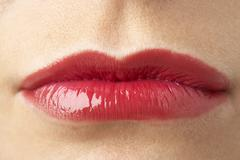 Extreme Close-Up Of Young Woman Wearing Red Lipstick Stock Photos