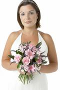 Portrait Of Bride Holding Bouquet Of Flowers - stock photo