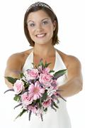 Portrait Of Bride Holding Bouquet Of Flowers Stock Photos