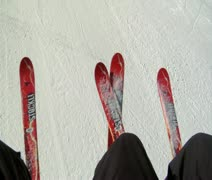 Shot of skiis on chairlift, snowy hill below Stock Footage