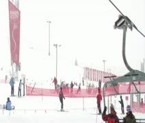 Shot of skiiers at base of hill on a snowy day Stock Footage