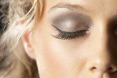 Extreme Close-Up Of Young Woman With Glamorous Make-Up Stock Photos