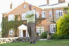 Senior Man Standing Outside House Stock Photos
