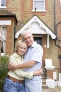 Couple Standing Outside Their House - stock photo