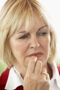 Portrait Of Middle Aged Woman Frowning Stock Photos