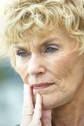 Senior Woman Lost In Thought - stock photo