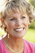 Portrait Of Senior Woman Smiling Happily Stock Photos
