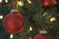 Red Christmas Baubles Hanging On Christmas Tree Stock Photos