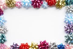 Border Made From Colourful Gift Bows Against White Background Stock Photos