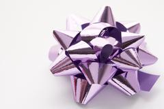 Purple Gift Wrap Bow Against White Background - stock photo