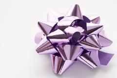 Purple Gift Wrap Bow Against White Background Stock Photos