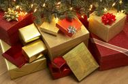 Stock Photo of Group Of Christmas Presents Under Tree