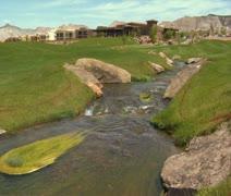 Stream flows through golf course Stock Footage