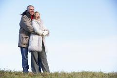 Senior Couple Embracing In Park Stock Photos